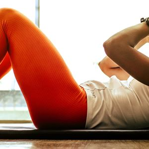 A woman performs sit ups