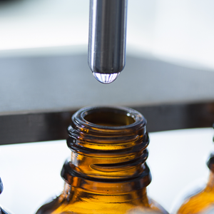 Medicinal canibis is poured into bottles by a machine