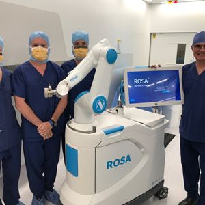 Surgeons stand next to a immer Biomet Knee platform