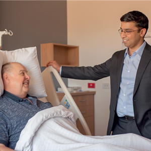 Dr Girish consults a patient bedside