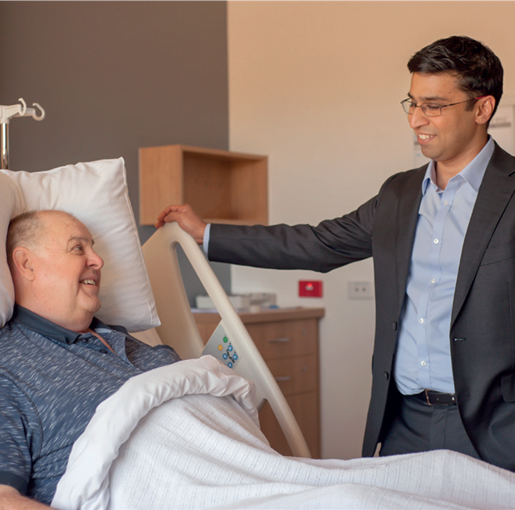 Spinal Surgeon Girish Nair consult a patient bedside