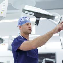An endocrine surgeon prepares for surgery