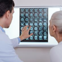 Doctor and patient look at brain scans