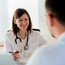 Speech pathologist consults a patient