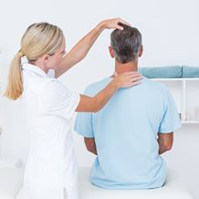 A doctor conducts a head & neck examination